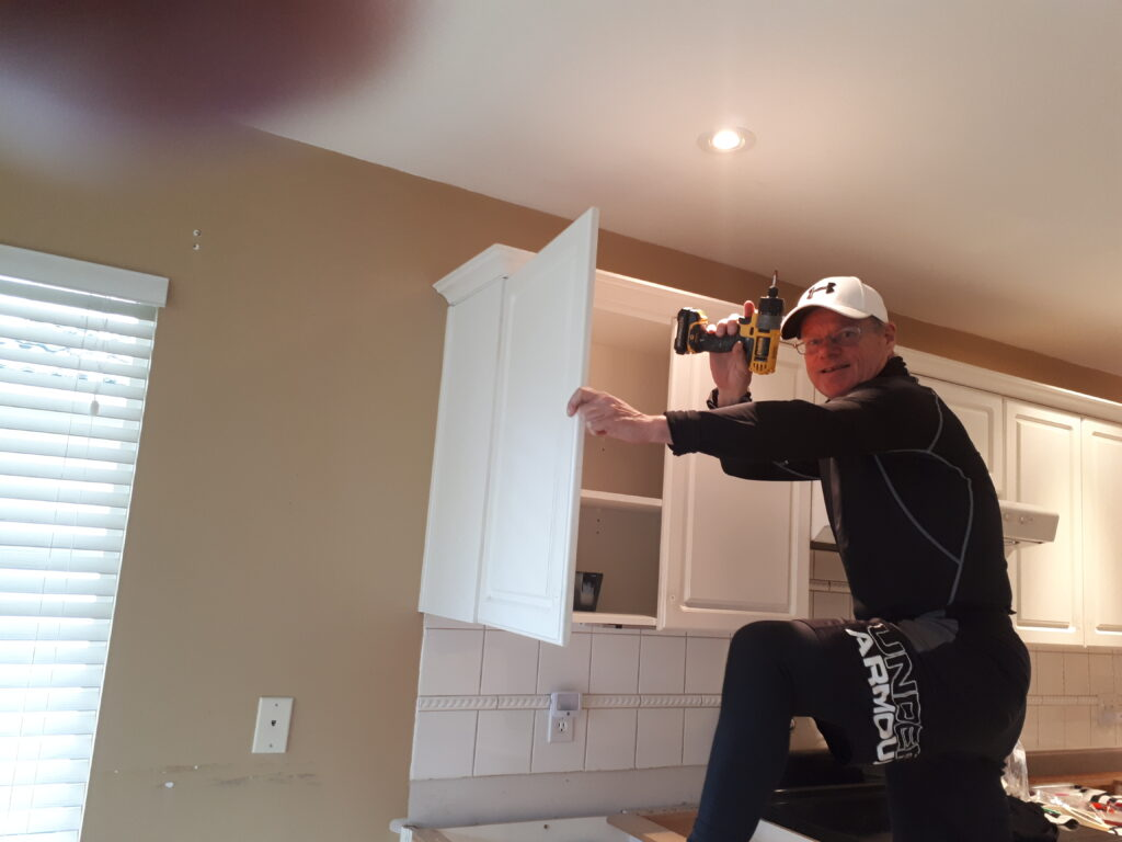 cabinet-painter-working
