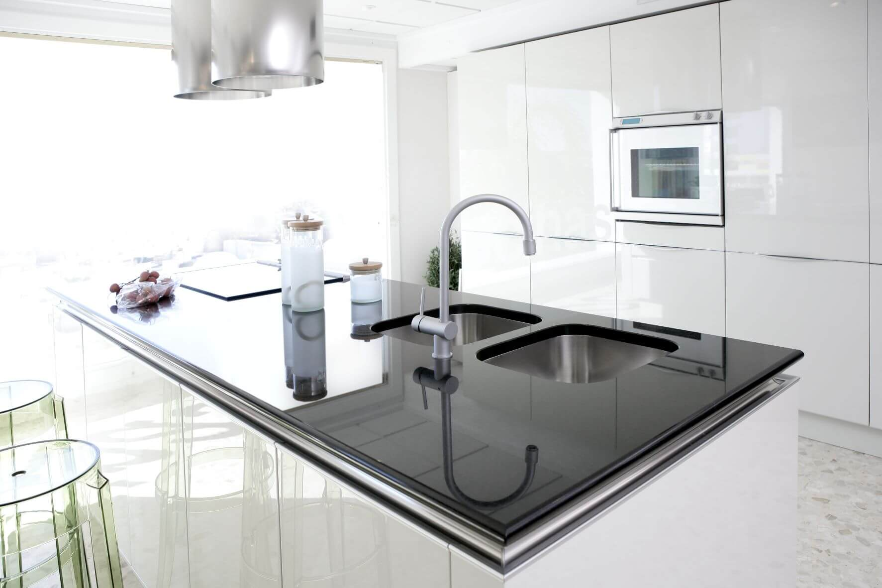 white glossy cabinets with black glosssy island countertop