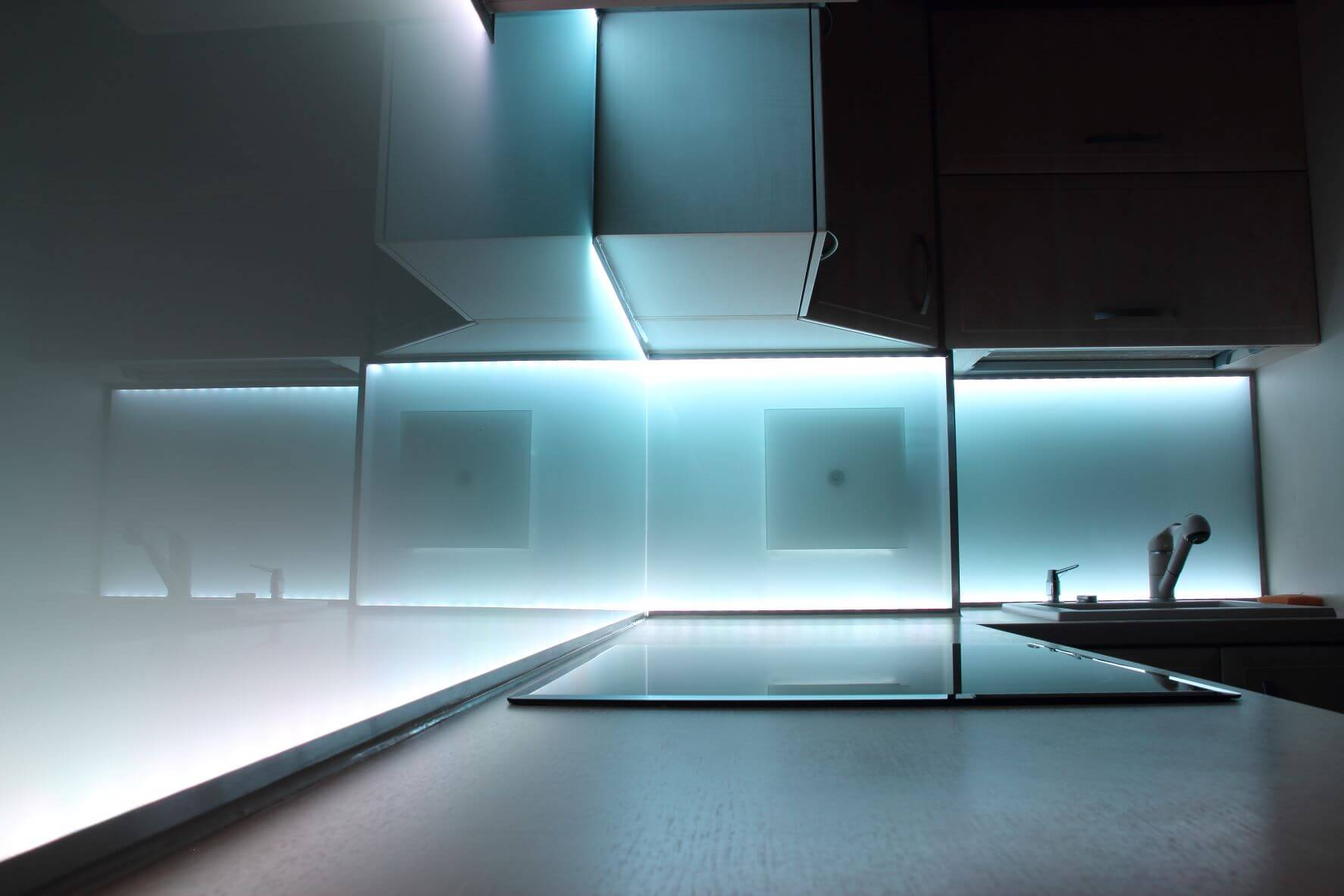 stylish night shot of glossy cabinets with luminescent LED lights giving sexy glow