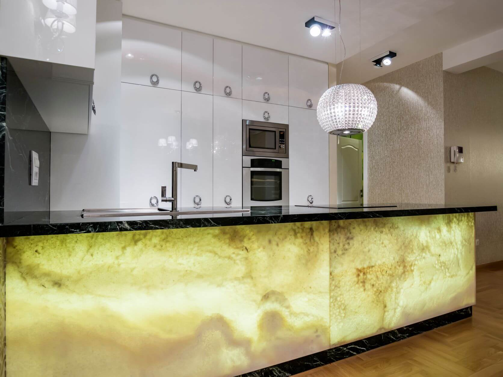 yellow and green faux finish on island with white cabinets